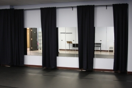 Rehearsal space photograph curtain walls open Mirrors showing