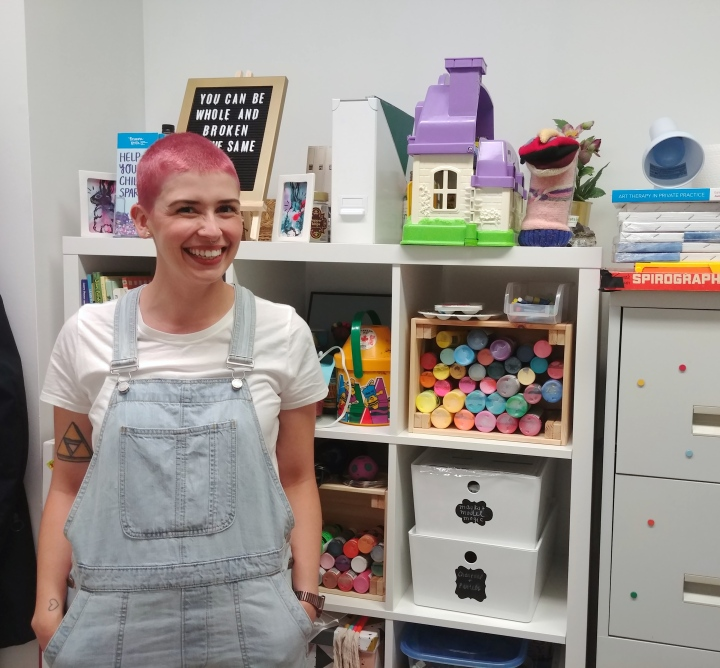Brianna With her art supplies in office